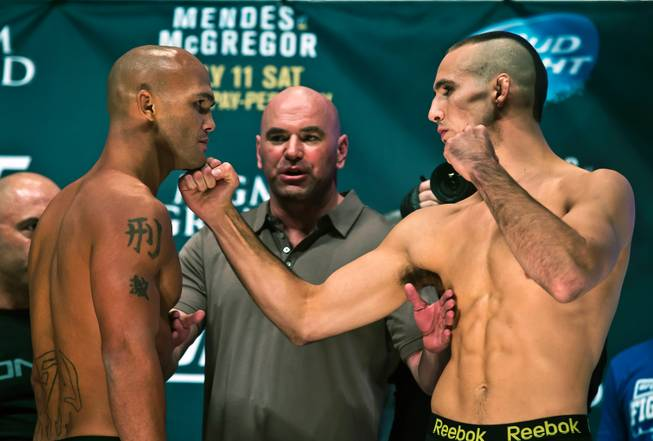 Lawler and MacDonald staredown at the weigh-ins | Photo courtesy of lasvegassun.com