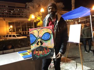 Dontrell Jackson posing with his favorite work of art.