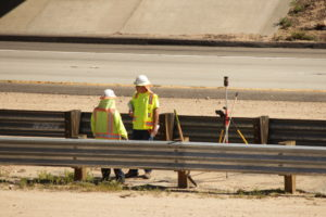 Construction crew collecting data for E. 210 Expansion Project